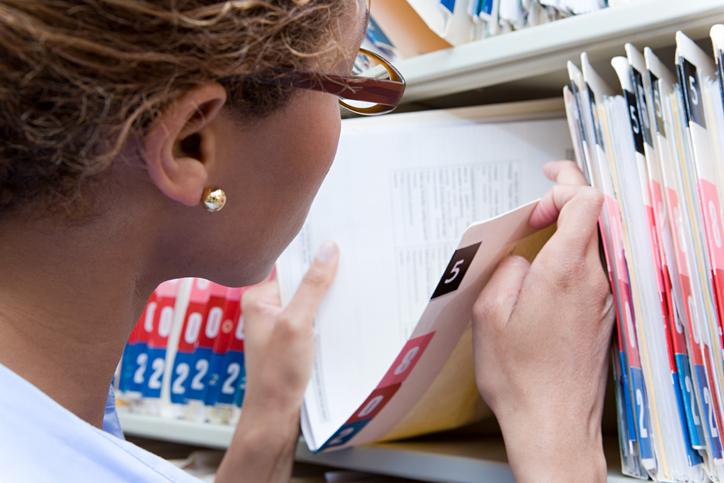 Case manager reviewing patient medical records